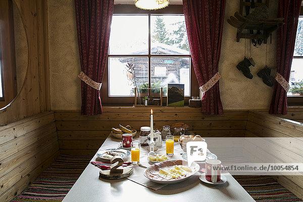 Breakfast table in log cabin
