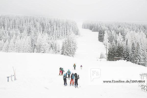 High angle view of skiers on ski slope  Tyrol  Austria