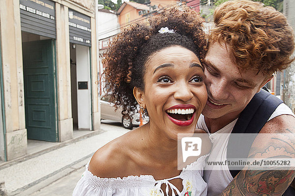 Young couple fooling around in street  laughing  close-up
