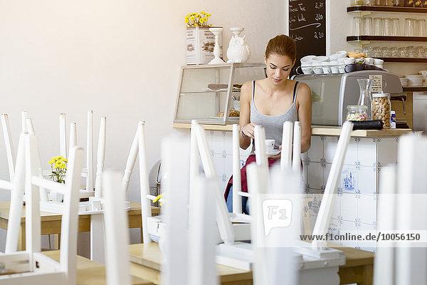 Waitress taking break in cafe
