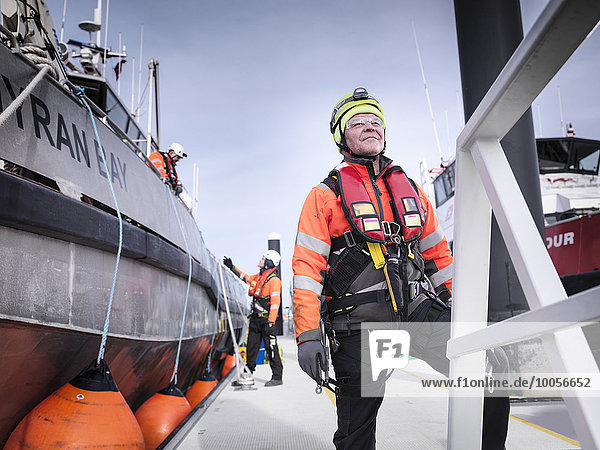 Offshore windfarm engineers in port with boats