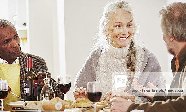 Senior friends at dinner table