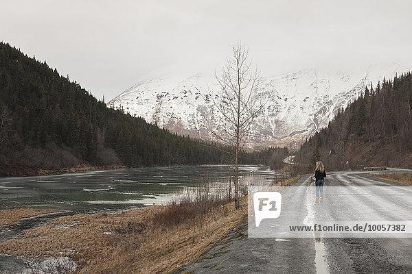 Young woman on road  Girdwood  Anchorage  Alaska