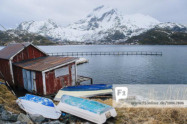 Fishing hut and upturned boats  Reine  Lofoten  Norway