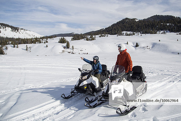 Friends on snowmobile  Jackson Hole  Wyoming