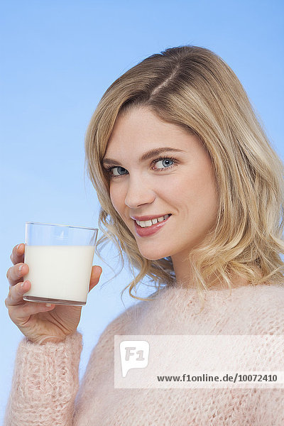 Close-up of a woman drinking milk