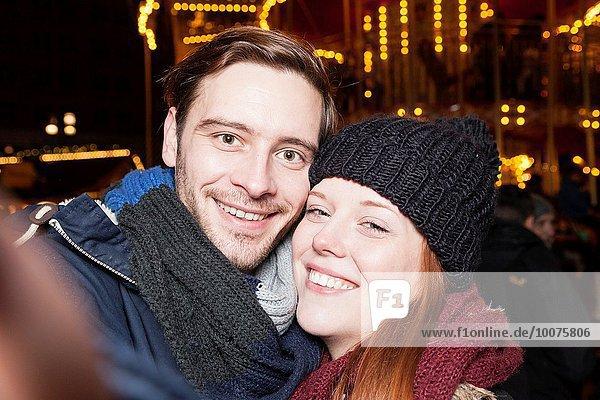 couple takes a selfie.