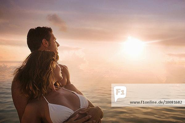 Europäer Sonnenuntergang Bewunderung über Ozean