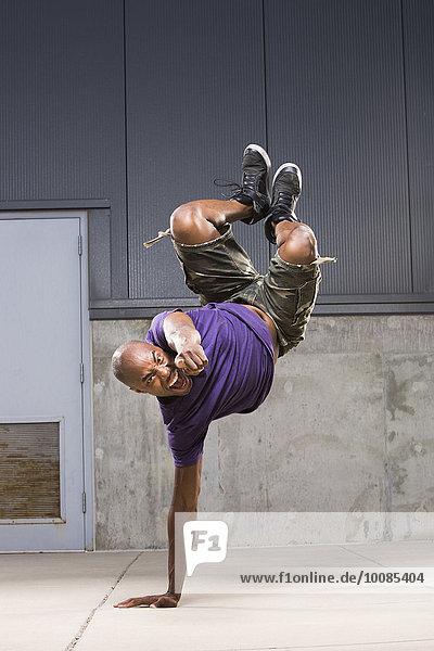 Black dancer balancing on hand