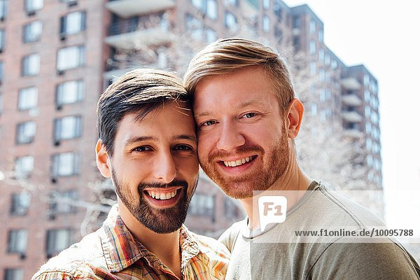 Portrait of male couple  smiling