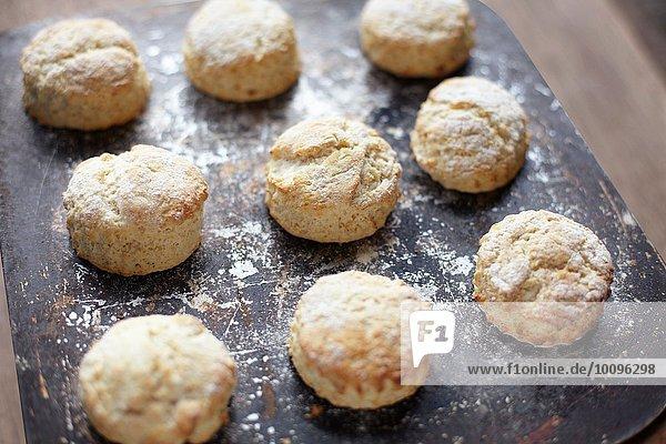 Nine freshly baked scones on baking tray
