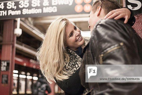 Romantic couple hugging on New York City subway platform  New York  USA