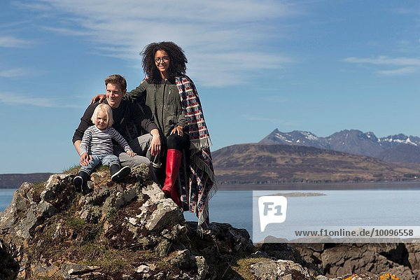 Family on rocks  Loch Eishort  Isle of Skye  Scotland