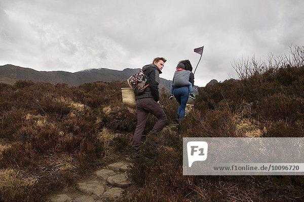Family hiking on path  Fairy Pools  near Glenbrittle  Isle of Skye  Hebrides  Scotland