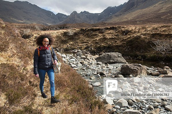 Mid adult woman hiking  Fairy Pools  Isle of Skye  Hebrides  Schottland