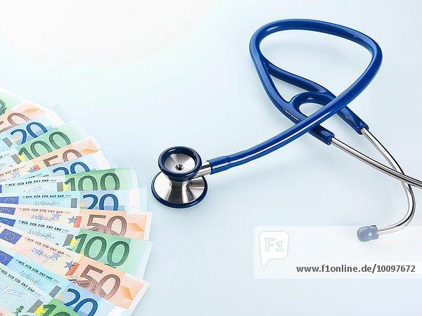 Stethoscope next to Euro notes