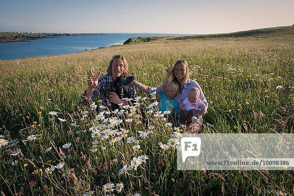 Portrait of family sitting on hillside  White strand  County Clare  Ireland