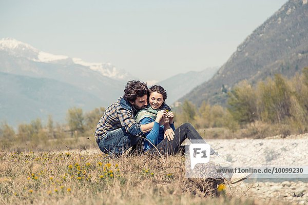Romantic couple hugging on riverbank  Vogogna  Verbania  Piemonte  Italy
