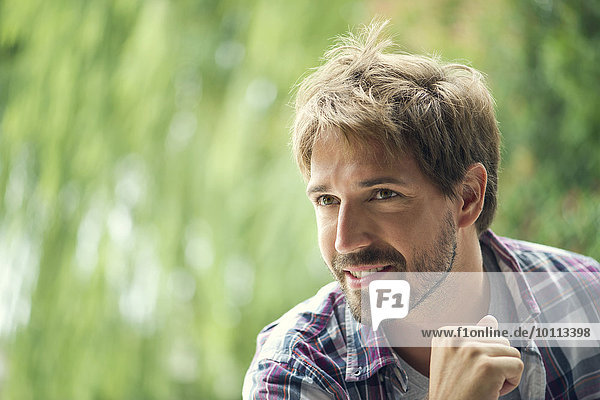 Man looking away in thought  portrait