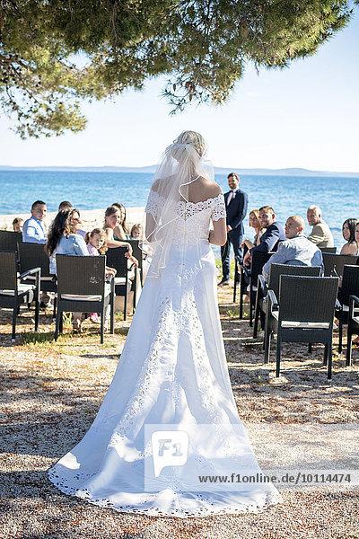 Braut Hochzeit Strand Zeremonie Rückansicht Ansicht