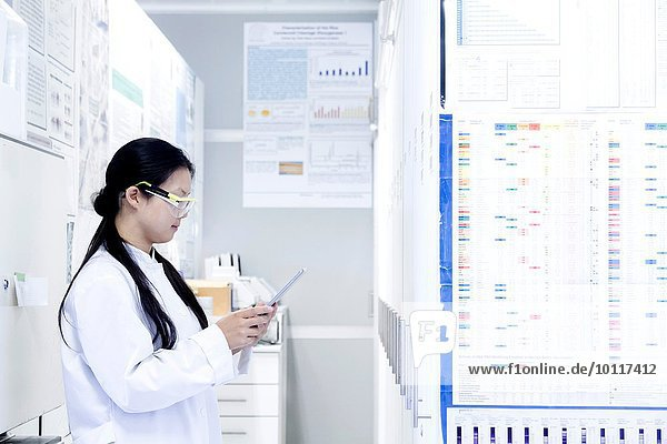 Female scientist looking at digital tablet in laboratory