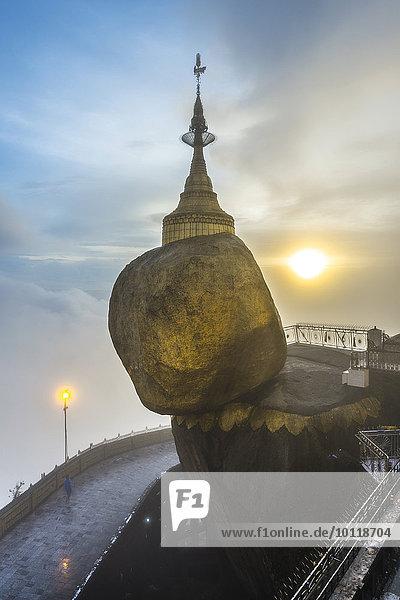 Golden Rock with Kyaiktiyo Pagoda in fog and sunset  Kyaikto  Thaton District  Mon State  Myanmar  Asia
