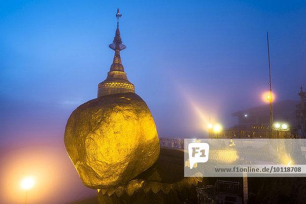 Golden Rock at dusk with Kyaiktiyo Pagoda  Kyaikto  Thaton District  Mon State  Myanmar  Myanmar  Asia