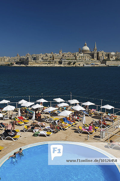 View from a hotel pool in Sliema towards Valletta  Malta  Europe