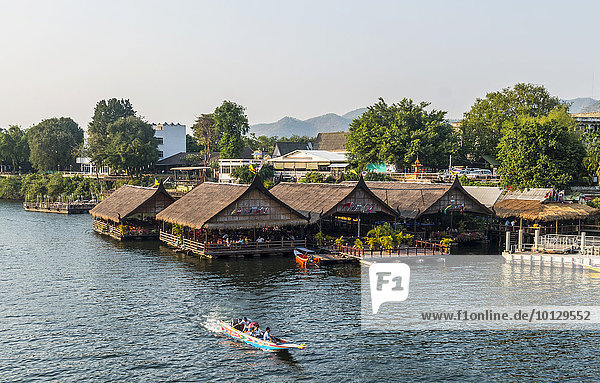 Longtail boat in front of floating houses  River Kwai  Kanchanaburi Province  Central Thailand  Thailand  Asia
