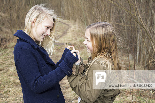 Girls playing in forest