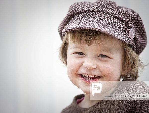 Smiling girl wearing cap