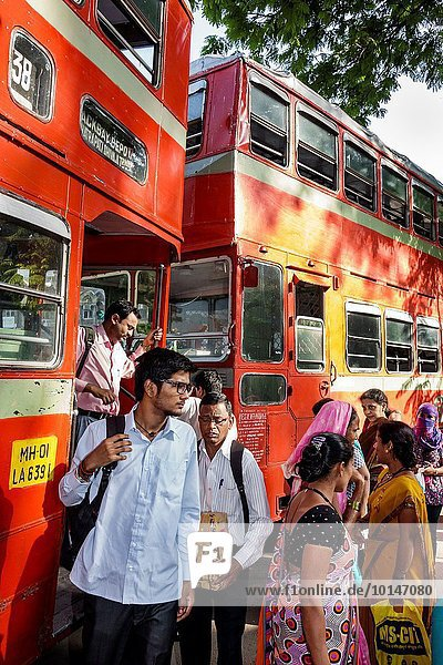 India  Indian  Asian  Mumbai  Fort Mumbai  Chhatrapati Shivaji Railway Station Terminus Area  BEST bus  double decker  stop  riders  passengers  getting off  man  woman