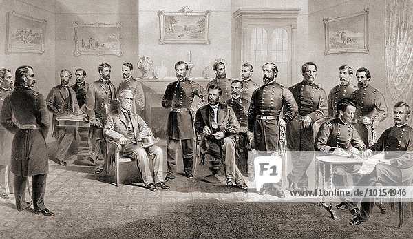 General Ulysses S. Grant (seated centre right) and General Robert E. Lee (seated centre left) with their respective staff at the Appomattox Courthouse  Virginia where General Lee surrendered the Army of North Virginia and thus ended the American Civil War. April 9  1865.