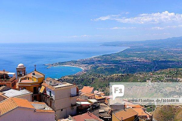View from Taormina village south to Giardino Naxos Bay,  Messina District,  Sicily,  Italy.