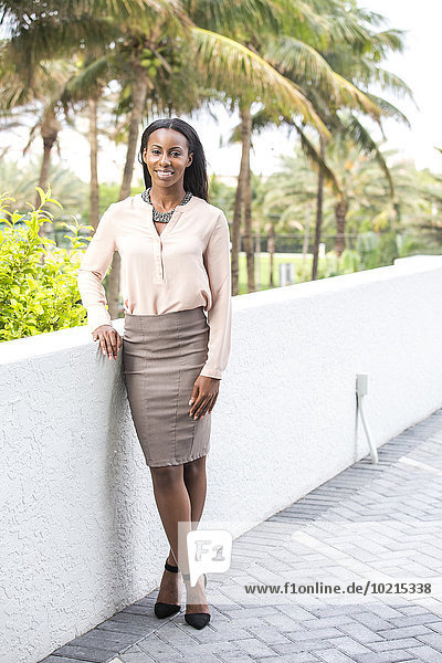 Smiling African American businesswoman standing outdoors