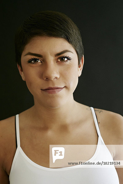 Close up of Hispanic woman with serious expression