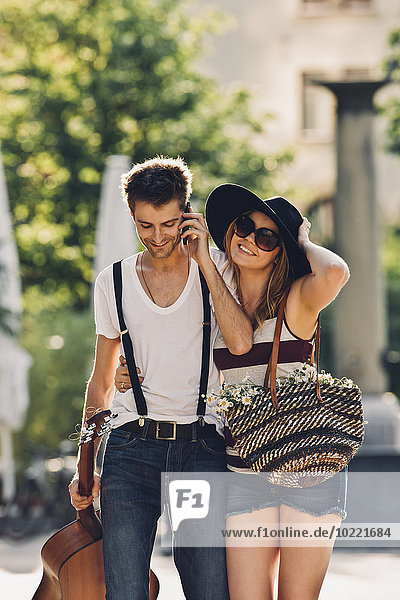 Portrait of young couple walking on the street