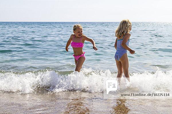 Greece  Corfu  Agios Georgios  two little girls bathing