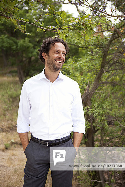 Germany  smiling businessman in forest
