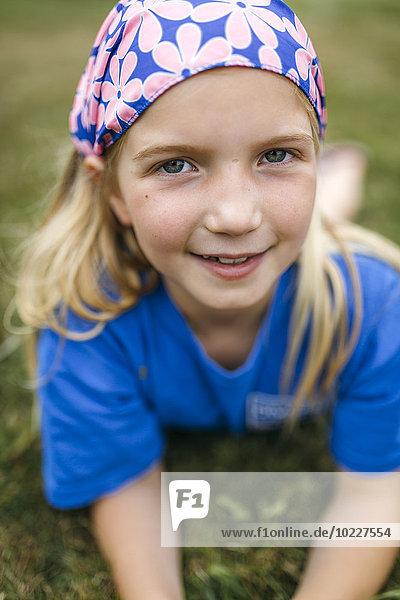 Portrait of little blond girl wearing
