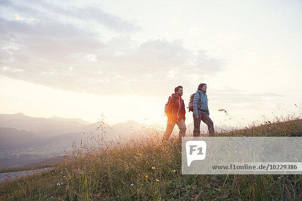 Austria  Tyrol  couple hiking at Unterberghorn at sunrise