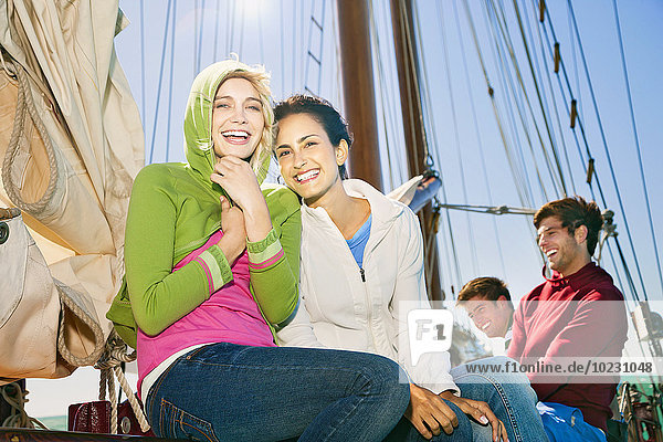 Happy friends on a sailing ship
