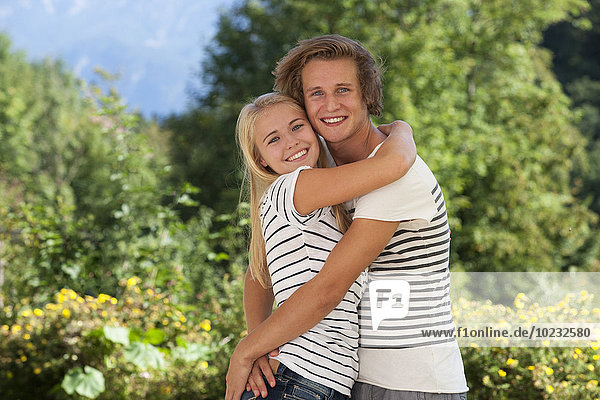 Portrait of hugging young couple in a garden