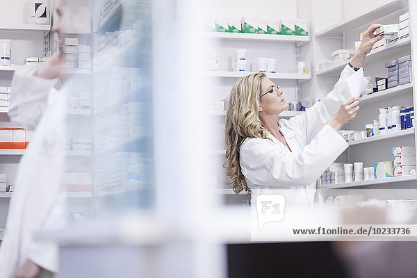 Pharmacist helping clients at pharmacy dispensary