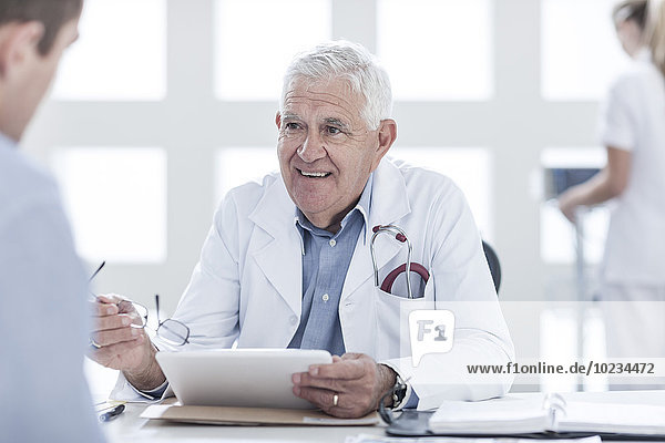 Patient consulting doctor