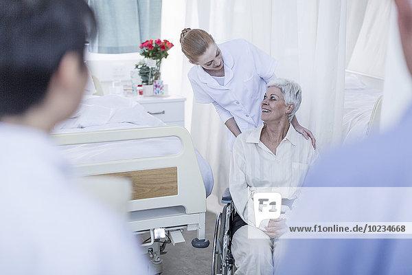 Nurse with elderly female patient in wheelchair
