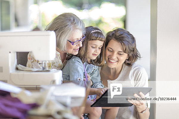 Mother  daughter and grandmother working on sewing machine