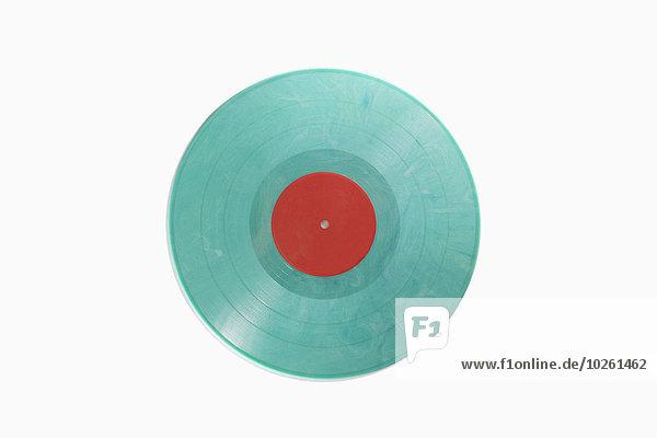Nahaufnahme der blauen Schallplatte vor weißem Hintergrund