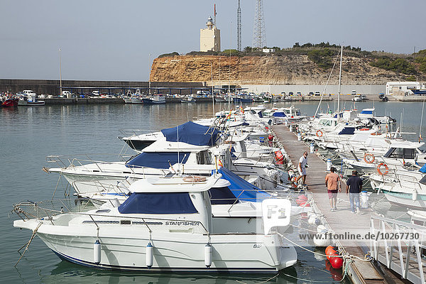 Boats moored along a dock in the harbour  near Conil; Andalusia  Spain