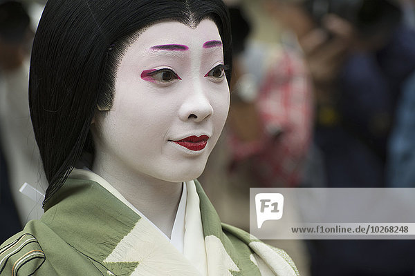 Close up portrait of a Japanese woman in kimono and parade makeup; Kyoto  Japan